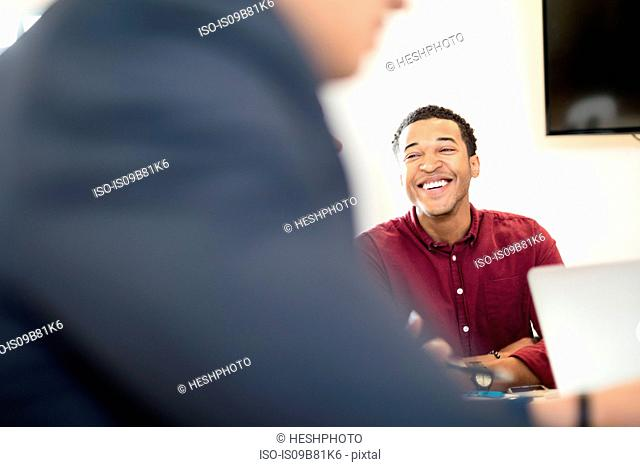 Over shoulder view of young businessman at office desk