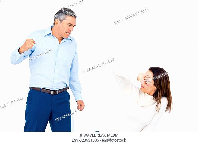 Angry man about to hit his wife