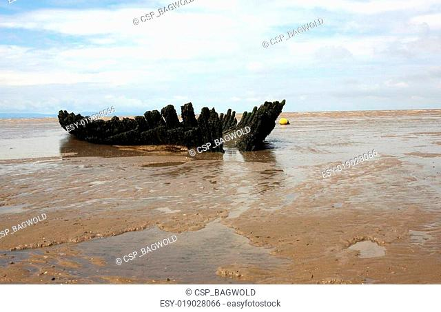 Old ship wreck on beach