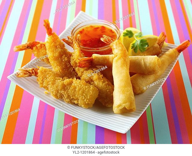 chinese starters - deep fried breaded prawns  spring rolls, dim sum, and samosas