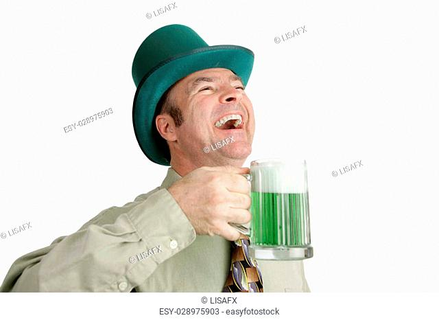 An Irish man on St. Patrick's Day, enjoying a green beer and a good laugh. Isolated on white