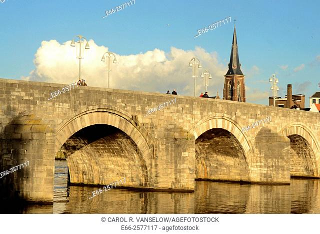 Sint Servatius bridge on the Maas River in Maastricht. St Martins church in background