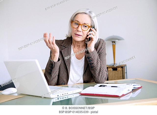 Elderly person teleworking