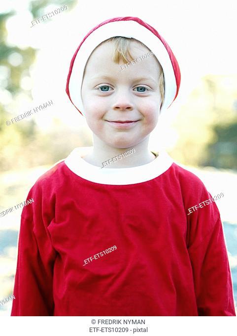 A boy dressed as Santa Claus Sweden