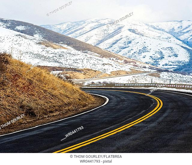 Road Through a Snowy Mountain Landscape