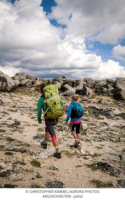 A mother and her young daughter backpacking in Cathedral Lakes Provincial Park, British Columbia, Canada