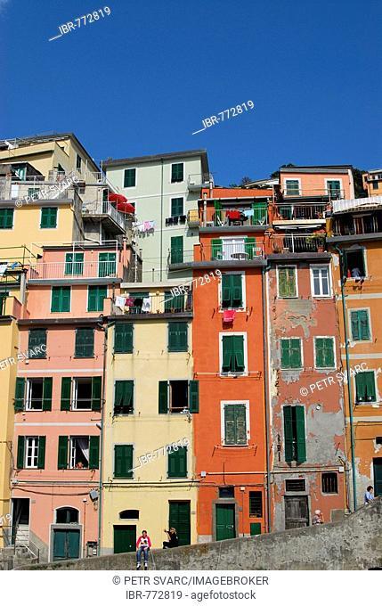 Colourful facades of houses in the village of Riomaggiore, Cinque Terre, Liguria, Italy, Europe