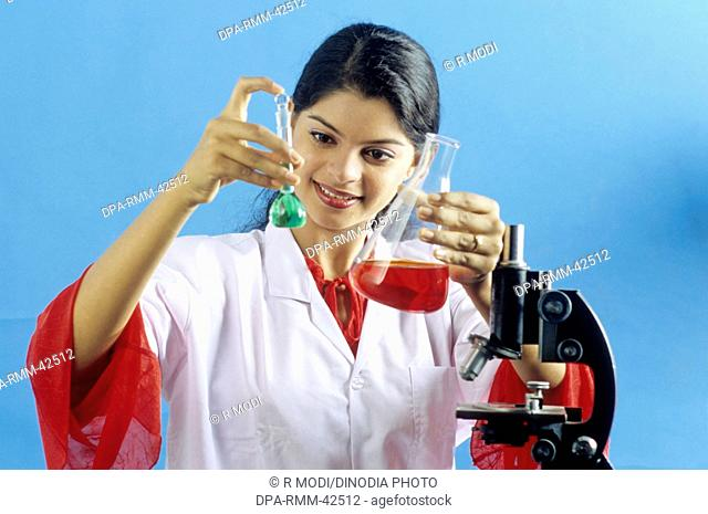 Indian Girl in Lab holding Chemical Flask MR.NO.579
