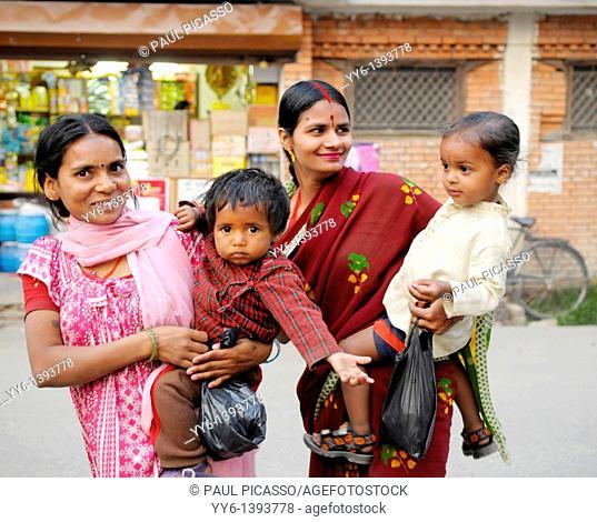 nepalese mothers with there children, the nepalis , life in kathmandu , kathmandu street life , nepal
