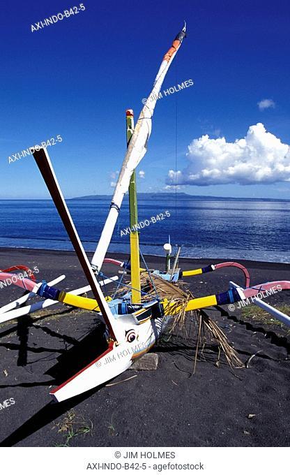 Fishing boats on black sand beach