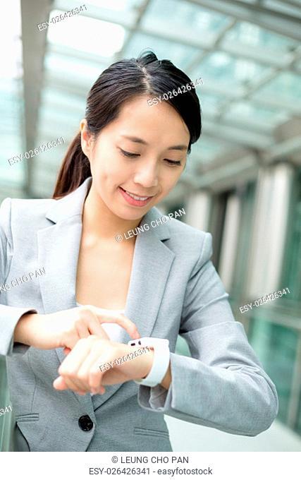 Business woman use of smart watch