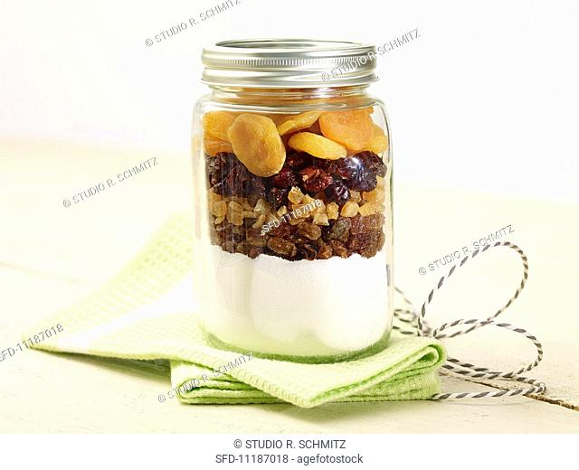 A jar containing the dry ingredients for making panettone