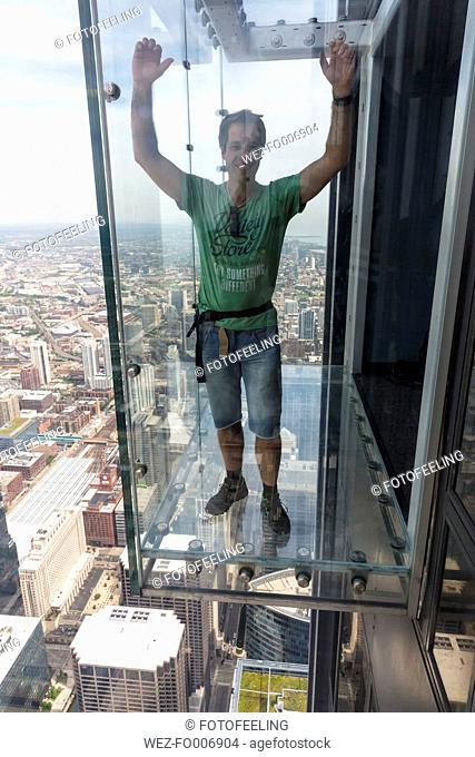 Chicago, Illinois, Chicago, Tourist on glass balcony of Willis Tower
