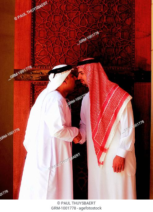 Arab men rubbing their noses (traditional greeting)