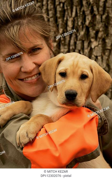Female Upland Bird Hunter With Yellow Lab Puppy