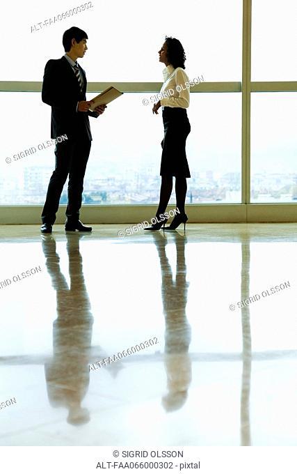 Executives talking in lobby