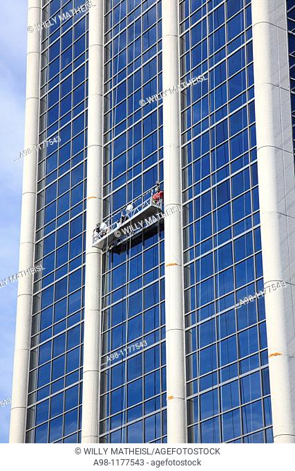 Window cleaners at one of the office towers at the Harbourwalk in Halifax, Nova Scotia, Canada, North America