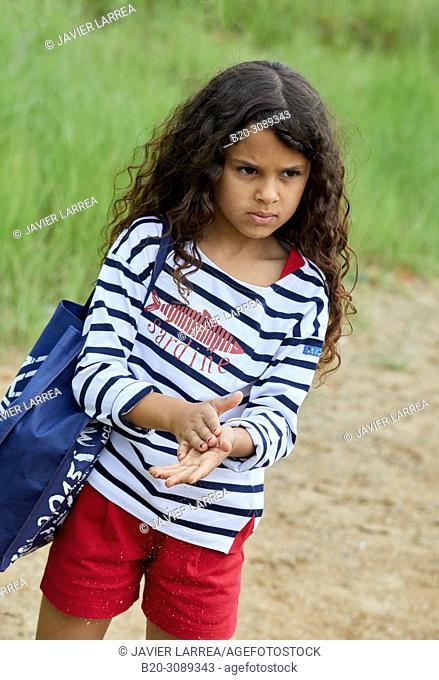 Girl in sailor clothes, Marina Urola, Santiago beach, Zumaia, Gipuzkoa, Basque Country, Spain, Europe