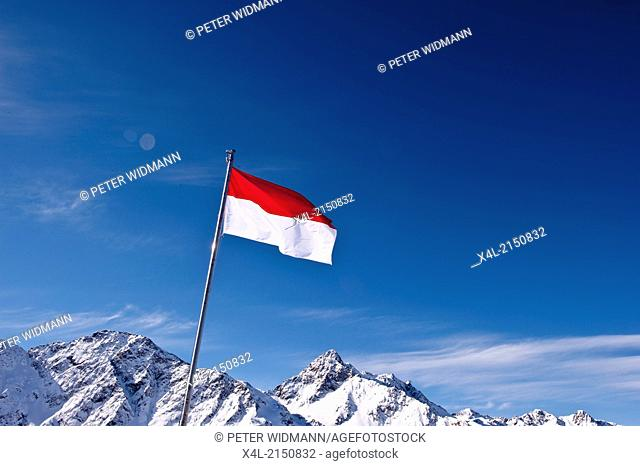 Austrian Flag in Front of Mountains
