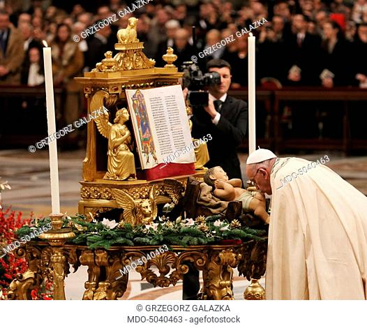 Pope Francis (Jorge Mario Bergoglio) kissing the statuette of the Child Jesus while celebrating the First Vespers and the Te Deum to give thanks for the year at...