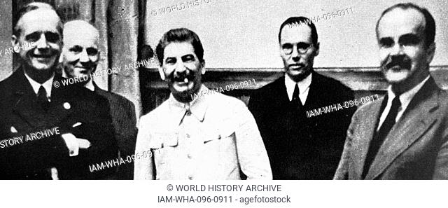 Stalin, Ribbentrop and Molotov after signing the Molotov–Ribbentrop Pact, (Nazi-Soviet Pact; German–Soviet Non-aggression Pact) 1939 was a treaty of...