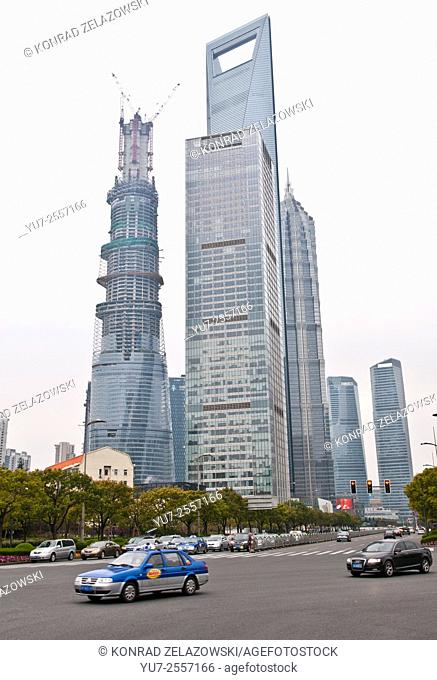 From left: Shanghai Tower, World Financial Center and Jin Mao Tower in Pudong, Shanghai, China. 21st Century Tower on foreground