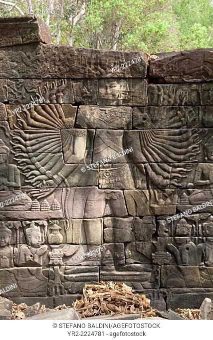 Rare carving depicting the Hindu god Vishnu with 32 arms, Banteay Chhmar temple, Cambodia