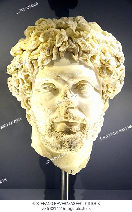 Marble portrait of a man with rich short hair curls and beard, resembling the portrait of emperor Marcus Aurelius. Gortyna, Roman period, 2nd cent. AD