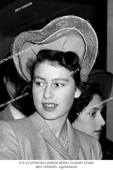 Princess Elizabeth pictured in November 1946 wearing a hat worn on the back of the head forming a heart shaped double halo and trimmed with veiling