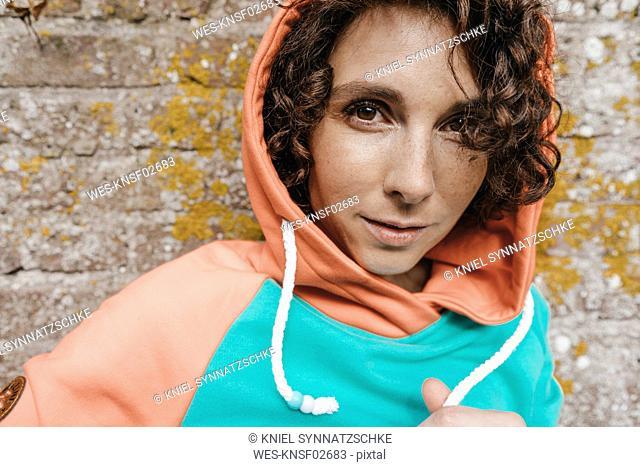 Portrait of woman wearing hoodie outdoors