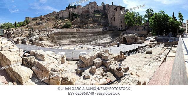Famous ancient Roman amphitheatre ruins at Malaga old town, Spain. Panoramic shot