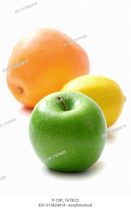 apple, lemon and grapefruit on white background