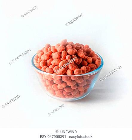 Nuts with pink glaze in bowl on white background isolated