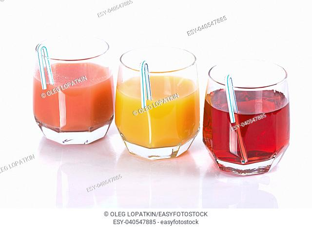 juice of different colors on a white background