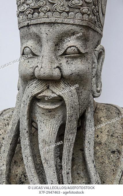 Detail of sculpture, garden at Wat Pho (Wat Po), Temple of the Reclining Buddha, Bangkok, Thailand