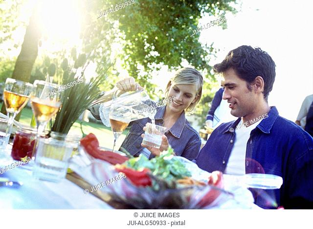 Man and woman at dinner party outdoors
