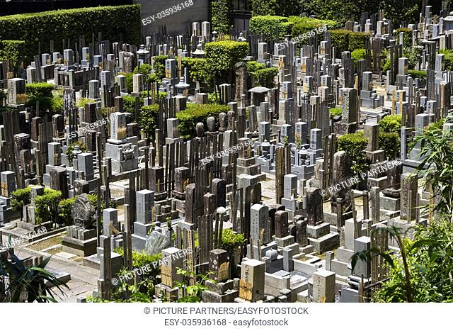 Kyoto, Japan, Old graves and headstones of the deceased at a Buddhist cemetery behind Chion-In temple in ancient Kyoto, Japan
