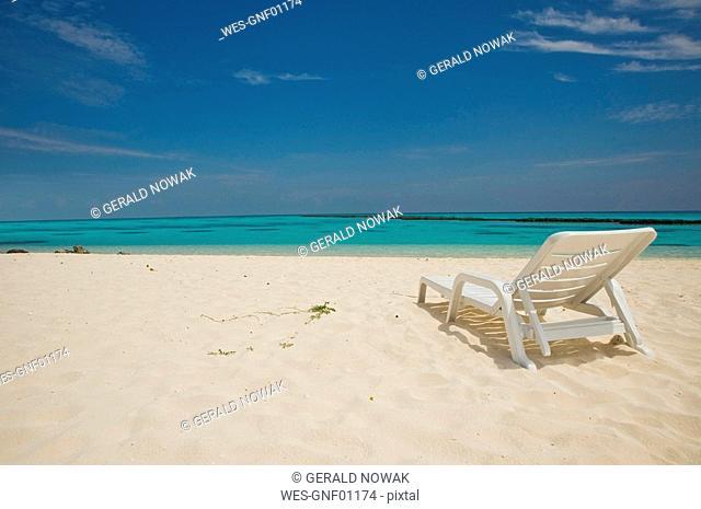 Maledive Islands, North Ari Atoll, Sunlounger on sandy beach
