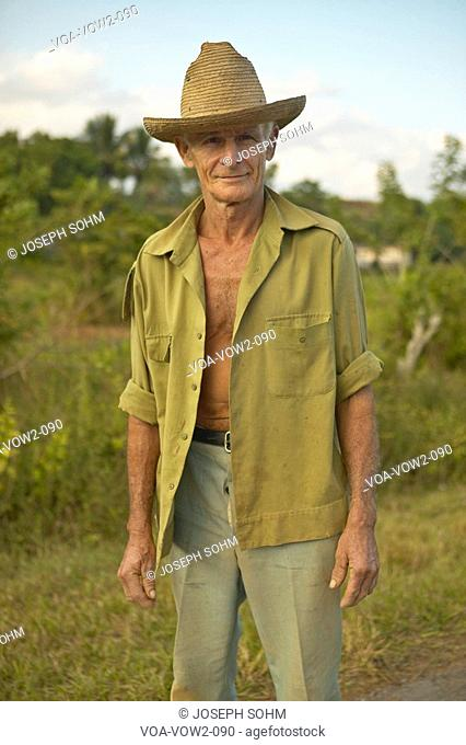 Man with hat posing for camera in the Valle de Viñales, in central Cuba