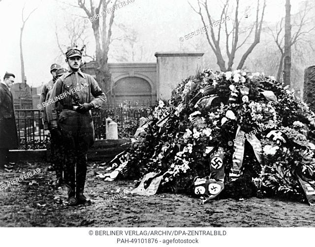 The Nazi propaganda photo shows members of the SA (Sturmabteilung) taking part in a guard of honor at the grave of a comrade who was killed during the so-called...
