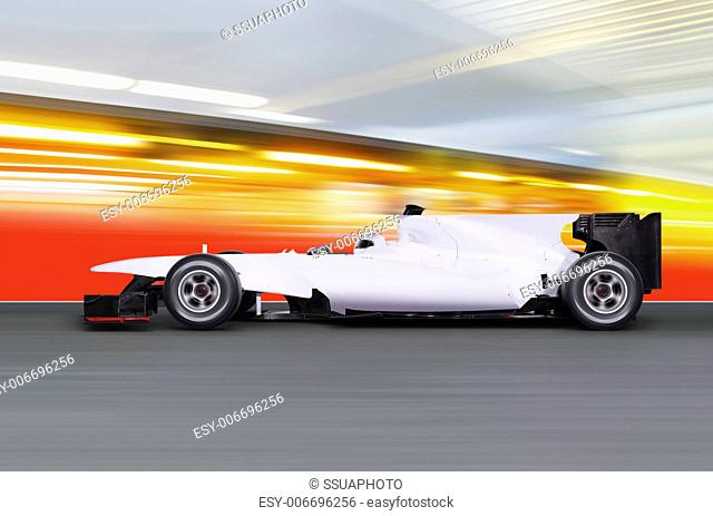 formula one car driving at high speed on empty road - motion blur