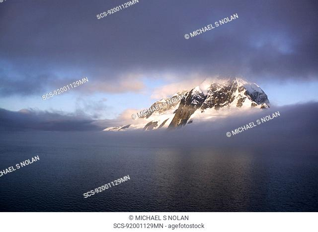 Shroud covered mountain peak in the magnificent Lemaire Channel, Antarctica