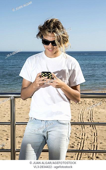 Man near sea using phone
