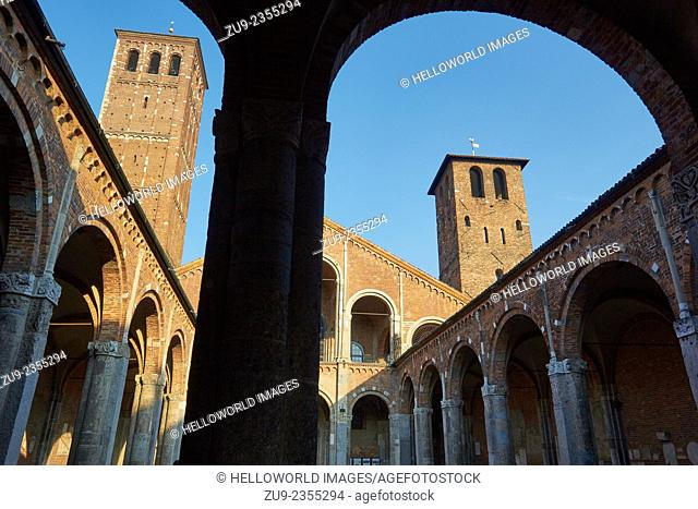 Arched courtyard entrance and two bell towers of Sant'Ambrogio church, Milan, Lombardy, Italy, Europe