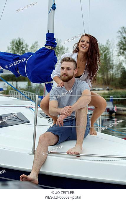 Couple relaxing together on a sailing boat