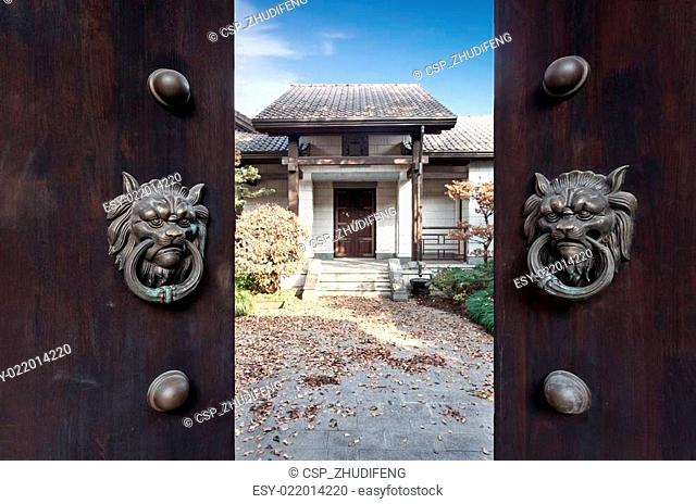 exterior of villa through old Chinese door