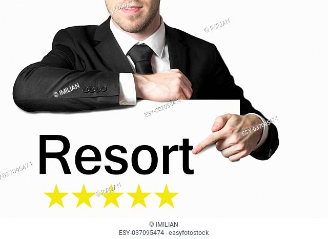 businessman in black suit pointing on sign resort five star rating