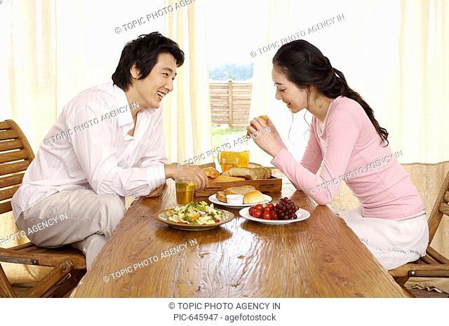 Young Korean Couple Having Breakfast