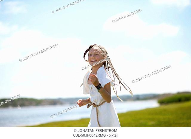 Girl running in Native American costume
