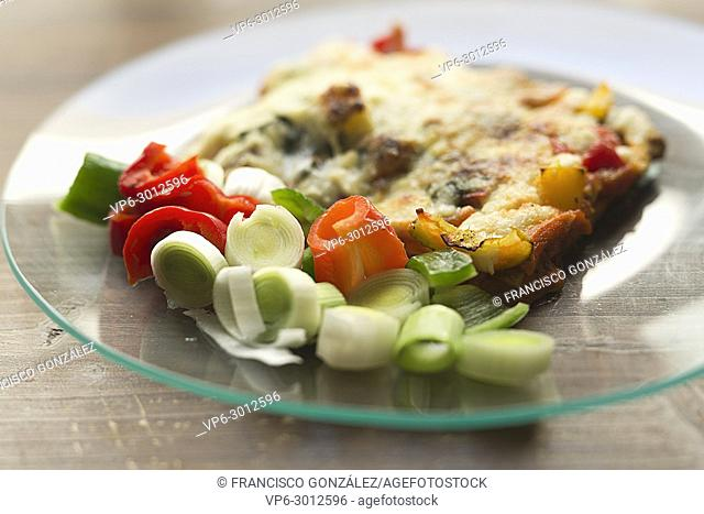 Vegetable lasagna in a glass dish on a wooden background